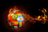 Composite image of fire surrounding international flag football — Stock Photo