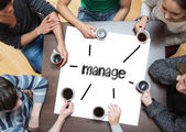 Manage on page with people around table — Stock Photo