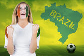 Excited ivory coast fan in face paint — Stock Photo