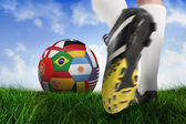 Close up of football boots at back of net — Stock Photo