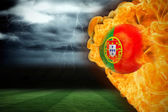 Composite image of fire surrounding portugal flag football — Stock Photo