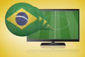 Composite image of football in brasil colours flying out of tv — Stock Photo