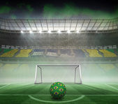 Composite image of football in brazilian colours — Stock Photo