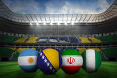 Composite image of footballs in group f colours for world cup — Stock Photo