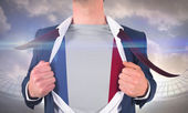 Businessman opening shirt to reveal france flag — Stock Photo