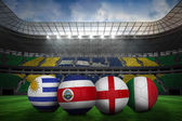 Composite image of footballs in group d colours for world cup — Stock Photo