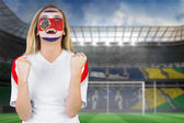 Composite image of excited costa rica fan in face paint cheering — Stock Photo