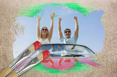 Couple cheering in convertible — Stock Photo