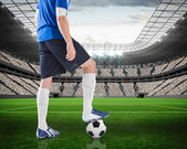 Composite image of football player standing with ball — Stok fotoğraf