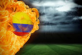 Composite image of fire surrounding colombia flag football — Stock Photo
