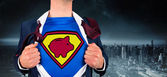 Businessman opening shirt in superhero style — Stock Photo