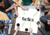 Tactics on page with people around table — Stock Photo