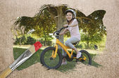 Composite image of little girl on a bike — Stock Photo