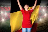 Imagen compuesta de animar aficionado al fútbol en rojo con Bélgica — Foto de Stock