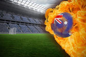 Composite image of fire surrounding australia flag football — Stock Photo