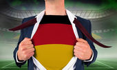 Businessman opening shirt to reveal germany flag — Stock Photo
