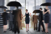 Composite image of redhead businesswoman in a blindfold — Foto de Stock