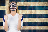Excited greece fan in face paint — Stock Photo