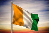 Composite image of ivory coast national flag on flagpole  — Stock Photo
