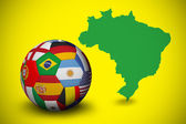 Composite image of football in multi national colours — Stock Photo