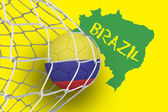 Composite image of football in colombia colours at back of net — Stockfoto