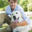Man with his labrador in the park — Stock Photo #46786931
