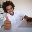 Businessman at his desk showing thumbs up — Stock Photo #46787001