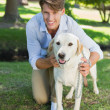 Man posing with his labrador in the park — Stock Photo