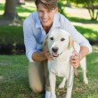 Man posing with his labrador in the park — Stock Photo #46788909