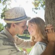 Couple leaning against tree in the park — Stock Photo #46789195