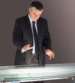 Concentrating businessman looking at desk  — Stock Photo