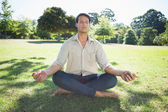 Man meditating in the park — Stock Photo