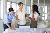 Team of architects having a conversation — Stock Photo