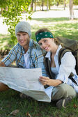 Couple on a hike holding map — Stock Photo