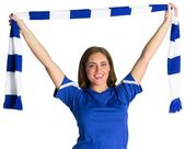 Pretty football fan waving scarf — Stock Photo