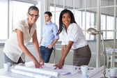 Architects analyzing plans together — Stock Photo