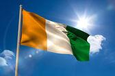 Ivory coast national flag on flagpole  — Stock Photo