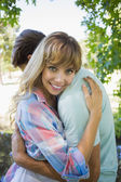 Blonde hugging boyfriend — Foto Stock