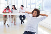 Businessman relaxing with coworkers — Stock Photo