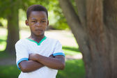 Boy frowning in the park — Foto Stock