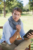 Man holding notepad and thinking — Stock Photo