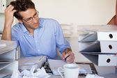 Businessmans workload getting bigger and bigger — Stock Photo