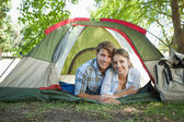 Couple lying in their tent — Foto Stock