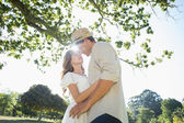Cute couple in the park embracing — Stock Photo