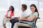 Businesswoman in wheelchair  in the workplace — Stock Photo