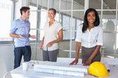 Workers looking at construction plans — Stock Photo