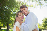 Cute couple hugging in the park — Foto Stock