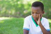 Upset boy thinking in the park — Stock Photo