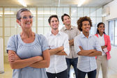 Business team with arms folded — Stock Photo