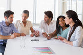 Business people discussing at a meeting — Foto Stock